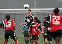 BOYDS, MARYLAND - July 21, 2012:  Holly King (16) of DC United Women heads the ball away from Melanie Adams-Cobb (9) of the Virginia Beach Piranhas during a W League Eastern Conference Championship semi final match at Maryland Soccerplex, in Boyds, Maryland on July 21. DC United Women won 3-0.