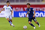 Takashi Inui of Japan (R) in action during the AFC Asian Cup UAE 2019 Group F match between Japan (JPN) and Uzbekistan (UZB) at Khalifa Bin Zayed Stadium on 17 January 2019 in Al Ain, United Arab Emirates. Photo by Marcio Rodrigo Machado / Power Sport Images
