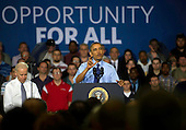 United States President Barack Obama and US Vice President Joe Biden speak to guests at the Community College of Allegheny County on April 16, 2014 in Oakdale, Pennsylvania. The President and Vice President are announcing new federal investments using existing funds to support job-driven training, like apprenticeships, that will expand partnerships with industry, businesses, unions, community colleges, and training organizations to train workers in the skills they need. <br /> Credit: Jeff Swensen / Pool via CNP