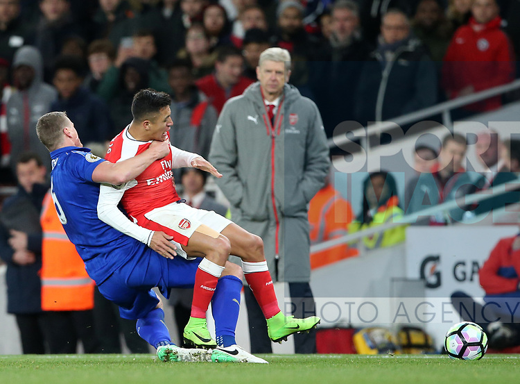 Arsenal's Alexis Sanchez gets fouled by Leicester's Robert Huth during the Premier League match at the Emirates Stadium, London. Picture date: April 26th, 2017. Pic credit should read: David Klein/Sportimage