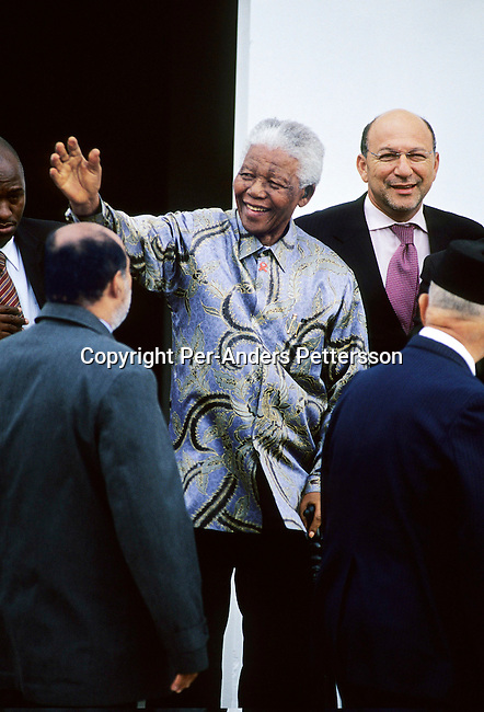 "CAPE TOWN, SOUTH AFRICA - FEBRUARY 11: Former president Nelson Mandela arrives at a ceremony on February 11, 2004 in Cape Town, South Africa. Mr. Mandela attended a ceremony celebrating the first newly built houses in District Six, as colored people were forced away during the sixties to make way for white residents during the Apartheid era. The area is now in the process of being re-constructed and some of the surviving people are soon to move in. Nelson Mandela retired in 1999 and now heads the ""Nelson Mandela Children's Fund"", a foundation supporting projects involving children in South Africa. (Photo by Per-Anders Pettersson/Getty Images)......"