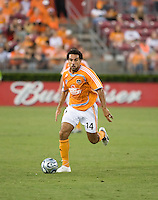 Houston Dynamo midfielder Dwayne De Rosario (14)  dribbles the ball. The Houston Dynamo tied The Columbus Crew 1-1 in a regular season MLS match at Robertson Stadium in Houston, TX on August 25, 2007.