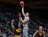 David Kravish of California shoots the ball during the game against Arizona State at Haas Pavilion in Berkeley, California on January 29th, 2014.   Arizona State defeated California, 89-78.