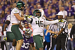 Oregon Ducks linebacker Kiko Alonso (47) celebrates with teammate Michael Clay after sacking Kansas State Wildcats quarterback Collin Klein in the first half of the Fiesta Bowl.