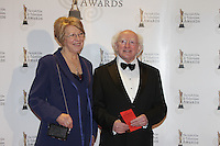 12/2/11 Michael D Higgins and Sabina Coyne on the red carpet at the 8th Irish Film and Television Awards at the Convention centre in Dublin. Picture:Arthur Carron/Collins