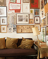 A quirky collection of artwork covers the walls of the living room