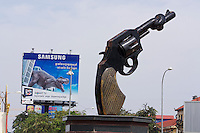 Phnom Penh, Cambodia. Knotted revolver sculpture at Stad Jas Circle (city entrance).