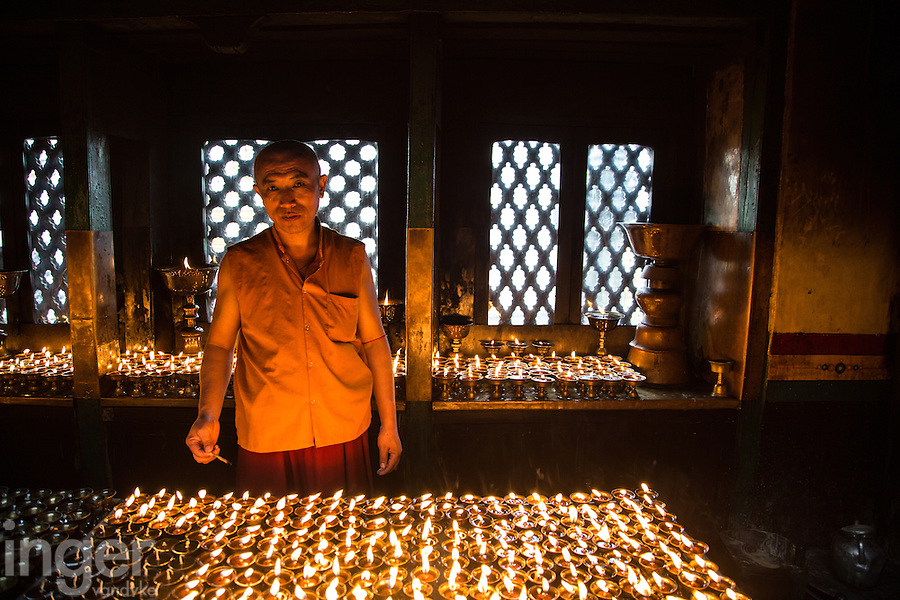 Monk Lighting Candles at Swayambhunath, Nepal