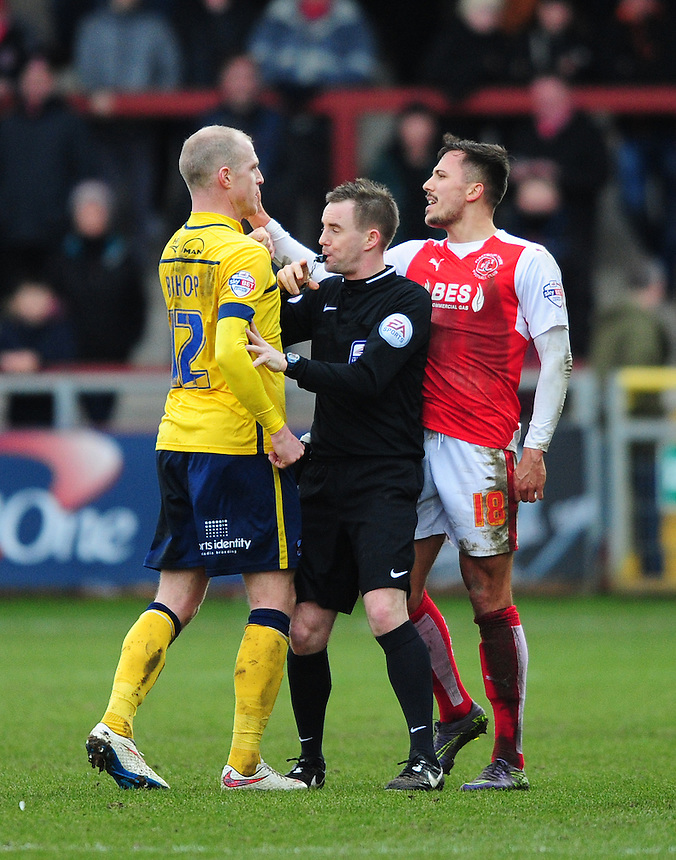 Referee Ross Joyce steps in to split up a heater discussion between Scunthorpe United's Neil Bishop and Fleetwood Town's Antoni Sarcevic which saw both players booked<br /> <br /> Photographer Chris Vaughan/CameraSport<br /> <br /> Football - The Football League Sky Bet League One - Fleetwood Town v Scunthorpe United  - Saturday 20th February 2016 - Highbury Stadium - Fleetwood    <br /> <br /> &copy; CameraSport - 43 Linden Ave. Countesthorpe. Leicester. England. LE8 5PG - Tel: +44 (0) 116 277 4147 - admin@camerasport.com - www.camerasport.com