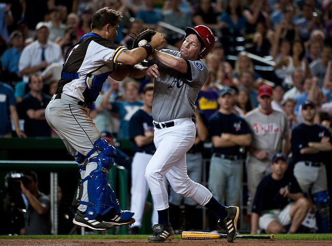 Democrats' catcher John Boccieri, D-Ohio, holds onto the ball as Rep. Connie Mack, R-Fla., charges home plate during the 49th Annual Roll Call Congressional Baseball Game at Nationals Stadium in Washington on June 29, 2010.
