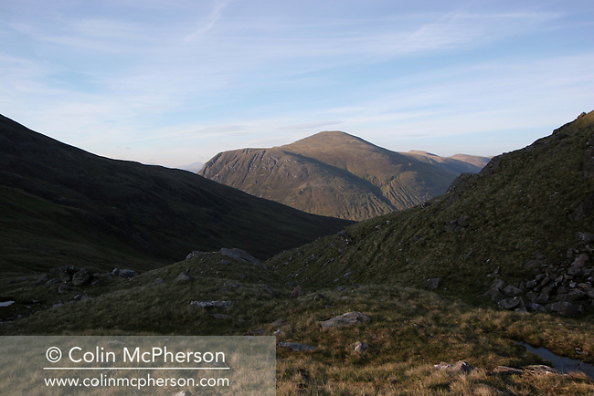 Looking towards Sgurr nan Ceannaichean a Munro mountain. The north west Highlands of Scotland is home to many Munros, mountains over 3000 feet (910 metres). Munrobagging was a popular pastime whereby climbers and walkers attempted to climb all 278 of Scotland's Munros.