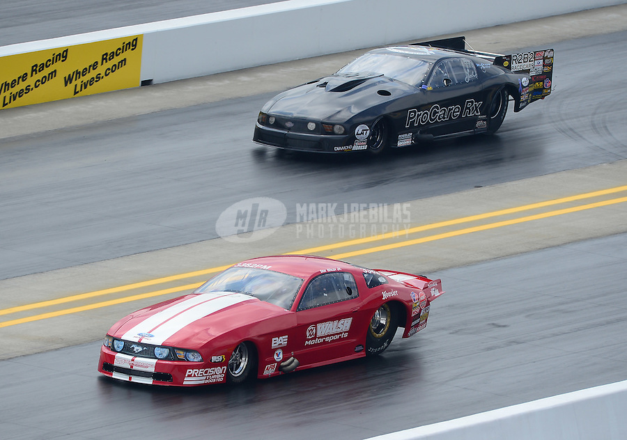 Apr. 15, 2012; Concord, NC, USA: NHRA pro mod driver Don Walsh Jr (near lane) races alongside Leah Pruett during the Four Wide Nationals at zMax Dragway. Mandatory Credit: Mark J. Rebilas-