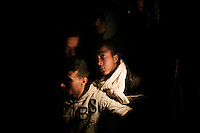 Lampedusa: immigrati tunisini sbarcano sull'isola di Lampedusa....Lampedusa: migrants from Tunisia arrives at the sea port at night,. A humanitarian emergency has been declared by the Italian government as over 16000 migrants have arrived on the island of Lampedusa in the last two months