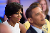 Washington, DC - July 21, 2009 -- First Lady Michelle Obama and United States President Barack Obama are pictured at an event celebrating country music in the East Room of the White House in Washington DC, USA on 21 July 2009. Artists scheduled to perform included Charley Pride, Brad Paisley and Alison Krauss and Union Station. .Credit: Matthew Cavanaugh / Pool via CNP