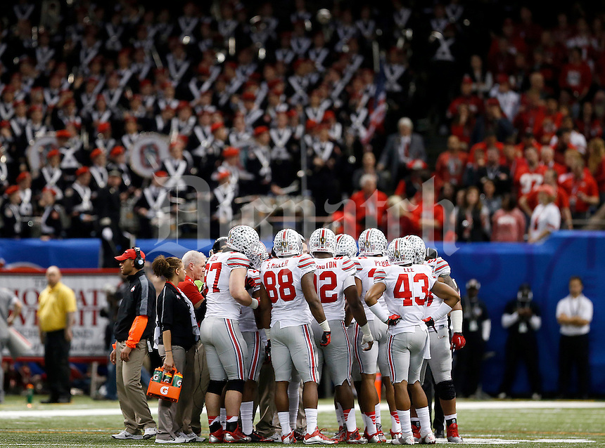 The Ohio State defense on the field during the fourth quarter in the Allstate Sugar Bowl college football playoff semifinal at Mercedes-Benz Superdome in New Orleans on Thursday, January 1, 2015. (Columbus Dispatch photo by Jonathan Quilter)