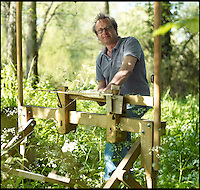 BNPS.co.uk (01202 558833)<br /> Pic: Mallinson/BNPS<br /> <br /> Creator Guy Mallinson.<br /> <br /> Release your inner Tarzan...in Britain's poshest treehouse.<br /> <br /> A luxury glamping site in deepest Dorset has created a luxurious treehouse that comes with its own sauna, hot tub, rotating fireplace and pizza oven.<br /> <br /> The Woodsman's Treehouse is perched 30ft from the ground on long stilts and has two floors. <br /> <br /> It has a spiral staircase and a stainless steel slide for quick access to the ground and can be rented out from &pound;390 a night. <br /> <br /> It is located at the Crafty Camping glamping site at Holditch in west Dorset.