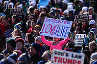 "Washington, DC - January 27, 2017: A woman holds a sign the reads ""Babies Need Love and Life"" as tens of thousands of people participate in the annual March for Life Rally on the National Mall in the District of Columbia, January 27, 2017.  (Photo by Don Baxter/Media Images International)"