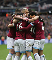 West Ham United's Mark Noble is congratulated after scoring his side's first goal<br /> <br /> Photographer Rob Newell/CameraSport<br /> <br /> The Premier League - West Ham United v Huddersfield Town - Saturday 16th March 2019 - London Stadium - London<br /> <br /> World Copyright © 2019 CameraSport. All rights reserved. 43 Linden Ave. Countesthorpe. Leicester. England. LE8 5PG - Tel: +44 (0) 116 277 4147 - admin@camerasport.com - www.camerasport.com
