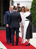 United States President Donald J. Trump, left, and first lady Melania Trump, right center, welcome President Andrzej Duda of the Republic of Poland, left center, and his wife, Agata Kornhauser-Duda, right, to the South Lawn of the White House in Washington, DC on Wednesday, June 12, 2019. <br /> Credit: Ron Sachs / CNP