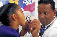 African-American doctor examines child patient