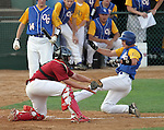 SIOUX FALLS, SD - MAY 26:  Alex Linneman #16 from O'Gorman is tagged out at home by catcher Kenny Dobberpuhl #4 from Roosevelt in the third inning during the Class A Championship Game Saturday night at the Sioux Falls Stadium. (Photo by Dave Eggen/Inertia)
