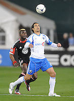 Montreal Impact forward Bernado Corradi (23) controls the ball against D.C. United defender Brandon McDonald (4) D.C. United tied The Montreal Impact 1-1, at RFK Stadium, Wednesday April 18 , 2012.