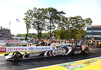 May 31, 2013; Englishtown, NJ, USA: NHRA top fuel dragster driver Shawn Langdon (near lane) races alongside Tony Schumacher during qualifying for the Summer Nationals at Raceway Park. Mandatory Credit: Mark J. Rebilas-