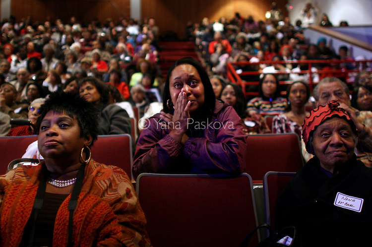 "Monette McLin, 39, actress from Chicago, (center,) cries while watching the inauguration of Barack Obama as President of the United States in the theater of the DuSable Museum of African-American History in Chicago, Illinois, on the Presidential Inauguration Day, Tuesday, January 20, 2009.  McLin said of Obama, ""That is a very inspirational man. I need that,"" as a self-described ""struggling"" actress. McLin's phone number is: 901.412.6568 (Photo by Yana Paskova for The New York Times)..Assignment ID: 30075164A"