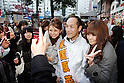 March 24, 2011, Tokyo, Japan - Former Gov. Hideo Higashikokubaru of Miyazaki prefecture, southern Japan, takes to the streets in Tokyo's Ikebukuro district on Thursday, March 24, 2011, as official campaigning for gubernatorial elections started in 12 prefectures including Tokyo. The 53-year-old comedian-turned-politician vies for the post against incumbent Shintaro Ishihara among other candidates in the April 10 election. (Photo by AFLO) [3609] -mis-..