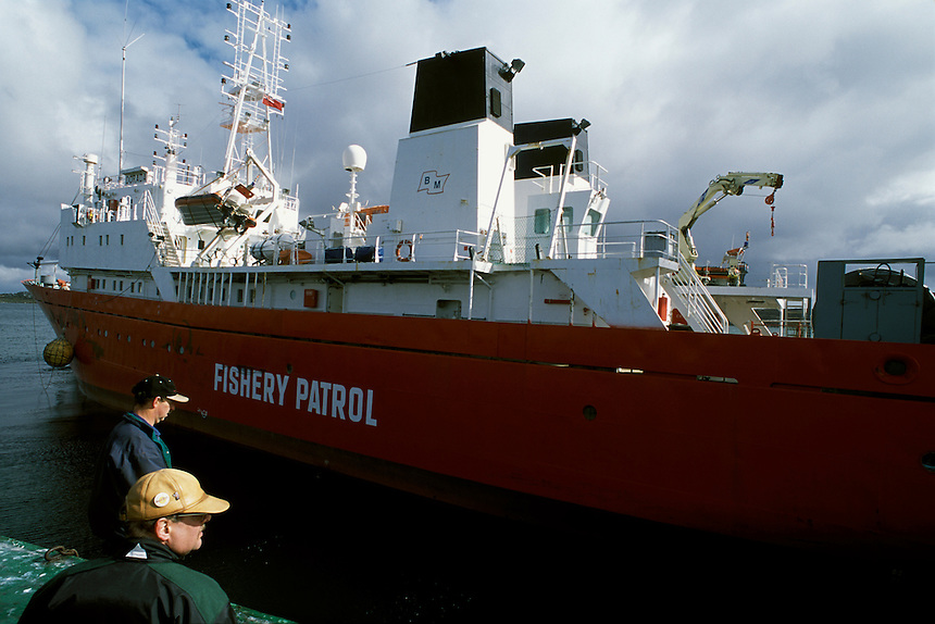 Capt. Trevor Betts, foreground, watches as the Dorada, one of two patrol vessels leased by the Falkland Islands Fishery Patrol, leaves port for a cruise in the Falkland Islands Conservation Zone. Created in 1986, the zone covers 34,000 square<br />