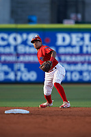 Clearwater Threshers shortstop Grenny Cumana (12) throws to first base during a game against the Palm Beach Cardinals on April 14, 2017 at Spectrum Field in Clearwater, Florida.  Clearwater defeated Palm Beach 6-2.  (Mike Janes/Four Seam Images)