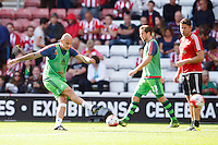 Jonjo Shelvey warming up during the Barclays Premier League match between Southampton v Swansea City played at St Mary's Stadium, Southampton