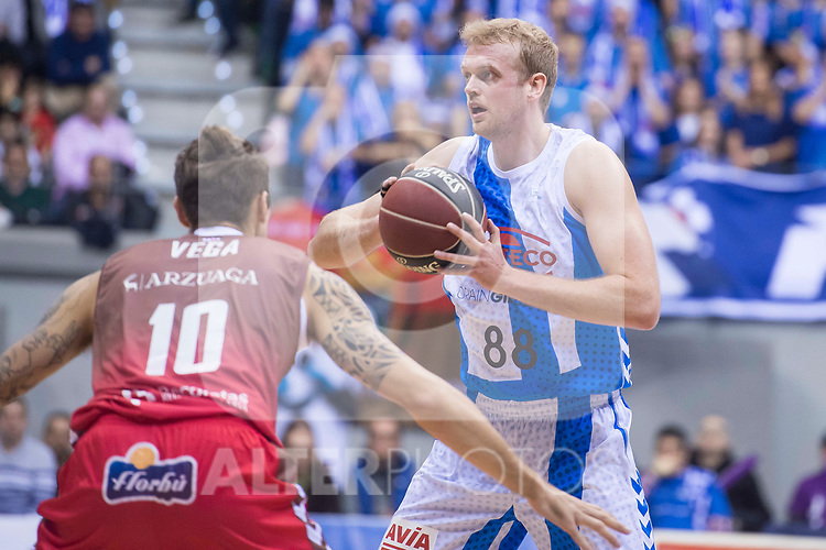 San Pablo Burgos Javi Vega and Gipuzkoa Basket Daniel Clark during Liga Endesa match between San Pablo Burgos and Gipuzkoa Basket at Coliseum Burgos in Burgos, Spain. December 30, 2017. (ALTERPHOTOS/Borja B.Hojas)