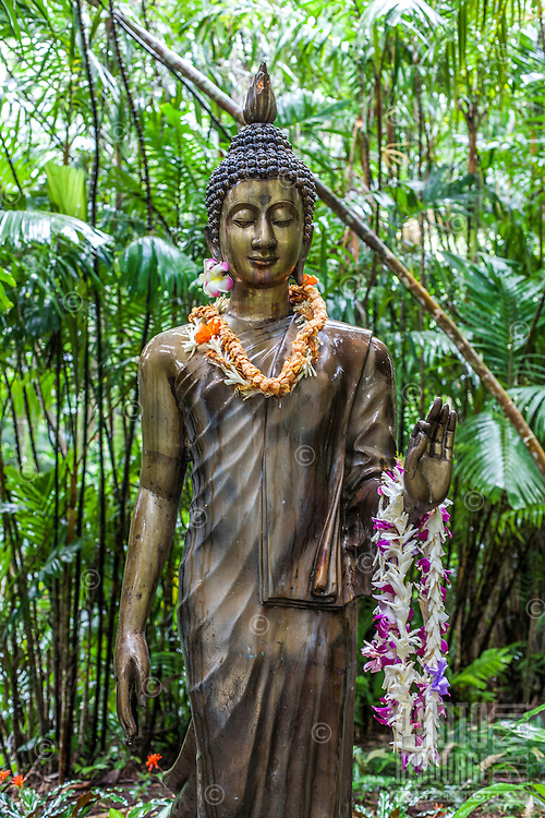 Buddha statue with lei at the Harold L. Lyon Arboretum and Botanical Garden, Honolulu, O'ahu.