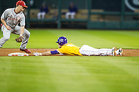 LSU Tigers shortstop Alex Bregman (8) slides safely into second base during a steal attempt at the Houston College Classic against the Nebraska Cornhuskers on March 8, 2015 at Minute Maid Park in Houston, Texas. LSU defeated Nebraska 4-2. (Andrew Woolley/Four Seam Images)