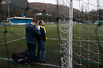 The away team complete some administration before Cambrian and Clydach Vale take on Cwmbran Celtic at King George's New Field in a Welsh League Division One match, the top division of the Welsh Football League and the second level of the Welsh football league system. The club, formed in 1965 reached the final of the 2018-19 League Cup final and can count on ex-England manager Terry Venables as a former club chairman. Cambrian and Clydach Vale won this match 2-0, watch by a crowd of around 100 spectators.
