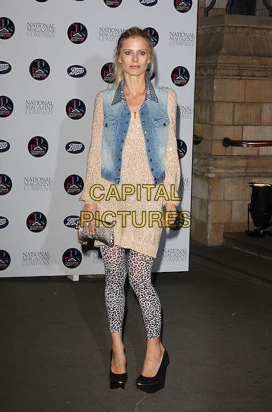 LAURA BAILEY.30 Days of Fashion & Beauty Gala Party at the Natural History Museum, Kensington, London, England. .September 21st, 2009.full length leopard print leggings blue denim jean vest waistcoat gold cream top grey gray bag purse black shoes wedges .CAP/ROS.©Steve Ross/Capital Pictures.