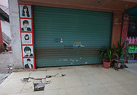 A shuttered barber shop is seen at the edge of the Yue Yuen Industrial Holdings Limited factory in Dongguan, Guangdong Province, China, 03 March 2015.