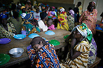 BUKAVU, DEMOCRATIC REPUBLIC OF CONGO - OCTOBER 30: Unidentified women and children wait for a meal to be served on October 30, 2007 at Panzi hospital outside Bukavu, DRC. Many of these women has been raped and abused by rebels and government soldiers. Many of the children are a result of rape. About 10 women and girls show up at the hospital every day and Dr. Denis Mukwege, a gynecologist and his staff does up to 20 reconstructive operations every day. He often has to perform complicated surgery to reproductive and digestive parts of the women. The DRC conflict has seen an unprecedented high rate of rape and sexual abuse of women. The culprits are both different rebel groups and government soldiers and very few are punished. About 27,000 sexual assaults were reported in South Kivu province alone in 2006, according to the United Nations. (Photo by Per-Anders Pettersson)