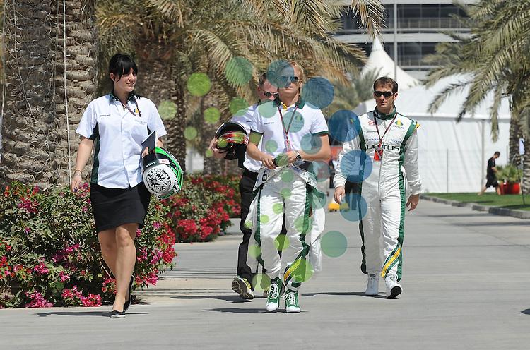 F1 GP Bahrain, Manama 12. - 14. March 2010.Heikki Kovalainen (FIN), Lotus F1 Racing - Jarno Trulli (ITA), Lotus F1 Racing ..Picture: Hasan Bratic/Universal News And Sport (Europe) 11 March 2010.