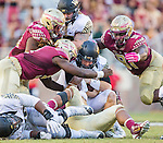 Florida State defenders Josh Sweat, left, Demarcus Christmas, top left, and Derrick Nnadi sack Wake Forest quarterback John Wolford in the second half of an NCAA college football game in Tallahassee, Fla., Saturday, Oct. 15, 2016. Florida State defeated Wake Forest 17-6. (AP Photo/Mark Wallheiser)
