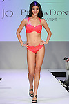Model walks runway in lingerie from Van de Velde, during the Lingerie Fashion Night - Romancing The Runway show, by CurvExpo and Lycra on February 23, 2015.