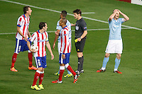 Atletico de Madrid´s Diego Godin and Mandzukic and Malmo´s Halsti during Champions League soccer match between Atletico de Madrid and Malmo at Vicente Calderon stadium in Madrid, Spain. October 22, 2014. (ALTERPHOTOS/Victor Blanco)
