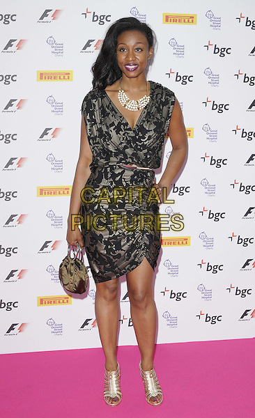 Beverley Knight.The F1 Party fundraiser in aid of Great Ormond Street Hospital, Battersea Evolution, Battersea Park, London, England..July 4th, 2012.full length black grey gray dress hand on hip silver open toe sandals shoes .CAP/CAN.©Can Nguyen/Capital Pictures.