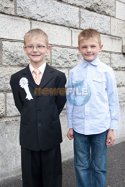 Kevin and Stephen Corr at St. Patrick's BNS First Communion at the Lourdes Church on Saturday. Picture: Newsfile/Mark Carroll.