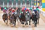 HOT SPRINGS, AR - FEBRUARY 19:#9, Rocking the Boat with jockey Fernando De La Cruz (center red green top)  going into the lead before first turn in the Razorback Handicap at Oaklawn Park on February 19, 2018 in Hot Springs, Arkansas. (Photo by Ted McClenning/Eclipse Sportswire/Getty Images)