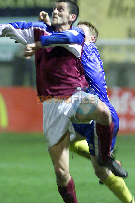 Drogheda uniteds gary Cummins making sure the Finn Harps Defence dont get the Ball..Picture Fran Caffrey Newsfile.