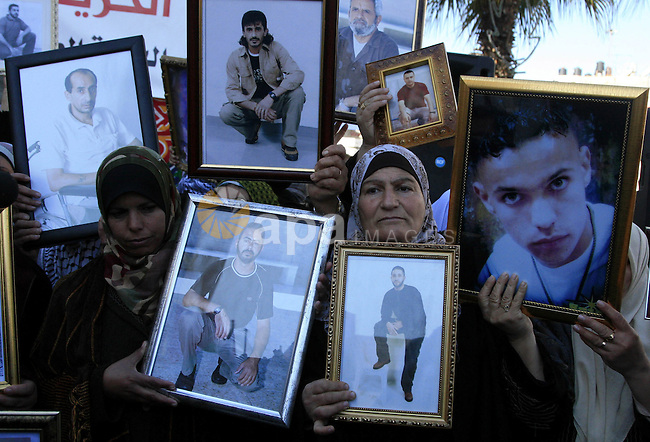 Palestinians relatives and family members holding the pictures of their jailed relatives on Israeli prisons, during solidarity rally in the West Bank town of Ramallah, 27 January 2010, demanding their release as one of the conditions for negotiations. Photo by Issam Rimawi