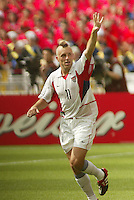 Clint Mathis celebrates his goal. The USA tied South Korea, 1-1, during the FIFA World Cup 2002 in Daegu, Korea.