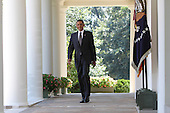 United States President Barack Obama smiles as he walks down the White House Colonade before he makes a statement on the economy in the Rose Garden on Monday, August 30, 2010.  .Credit: Dennis Brack / Pool via CNP